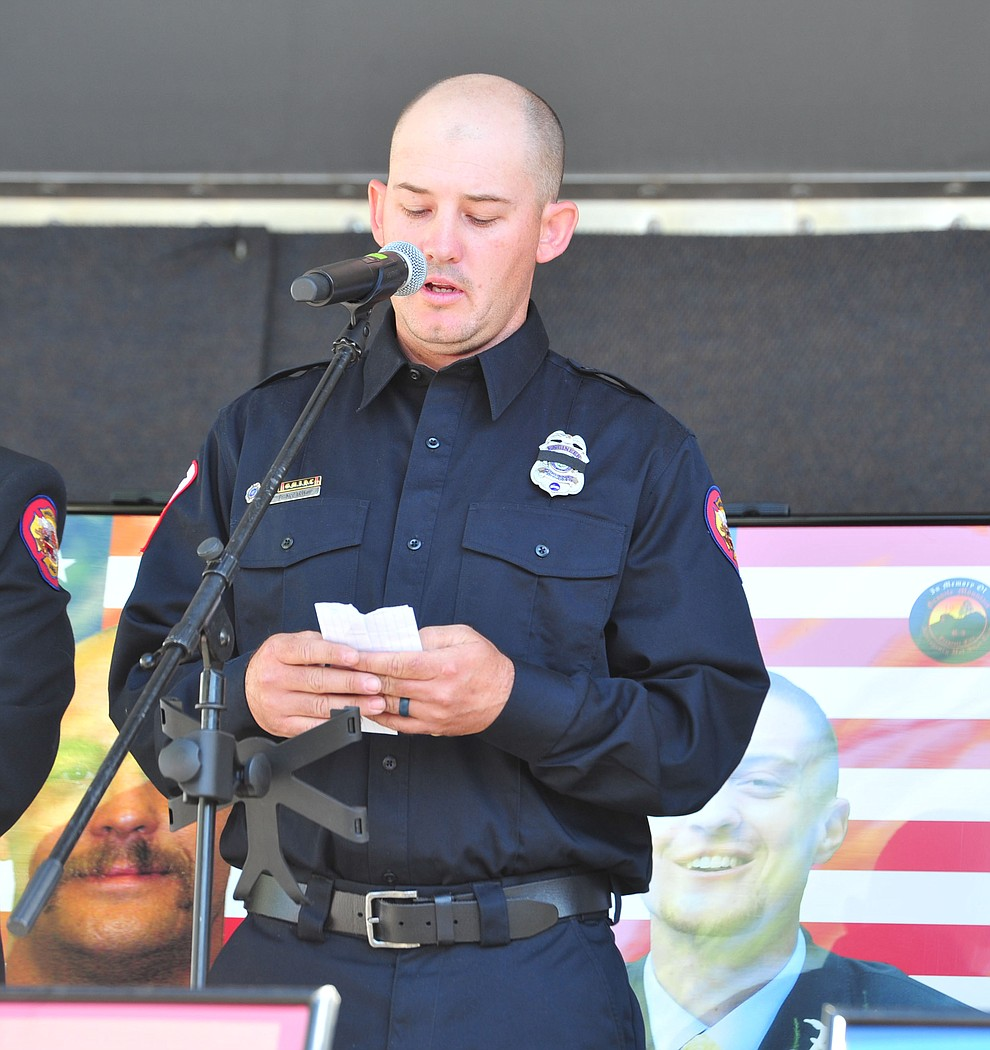 Prescott Firefighter and Granite Mountain Hotshot alumni Patrick McCarty reads the names of the fallen during a Remembrance Ceremony for the 19 Granite Mountain Hotshots Saturday, June 30, 2018.(Les Stukenberg/Courier)