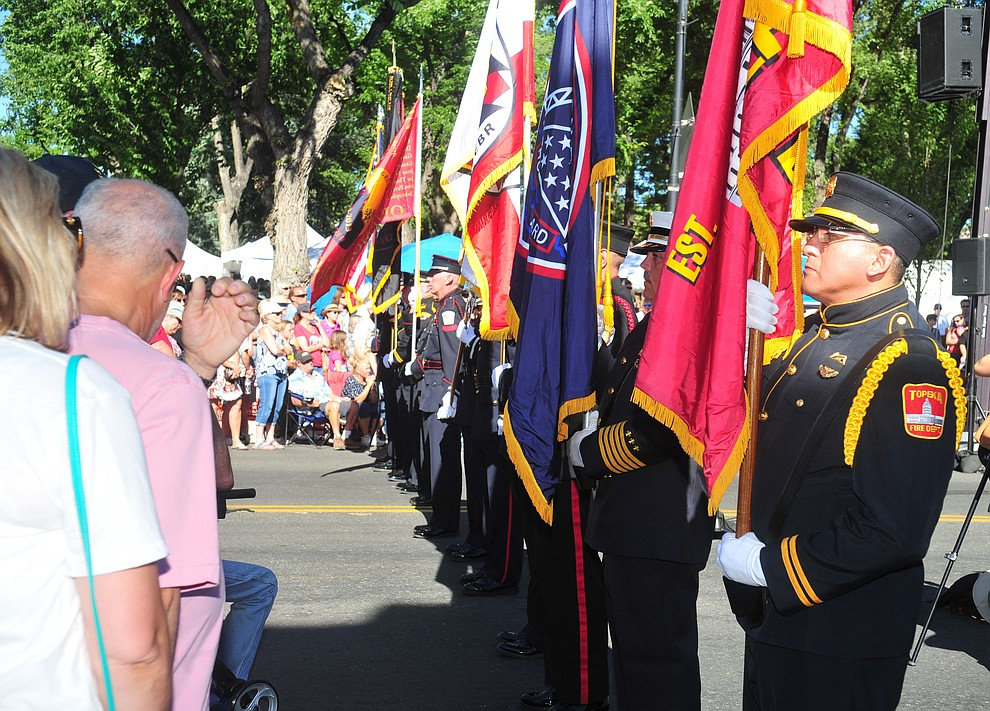 A joint fire service honor guard posts the colors during a Remembrance Ceremony for the 19 Granite Mountain Hotshots Saturday, June 30, 2018 on Montezuma Street in downtown Prescott.(Les Stukenberg/Courier)