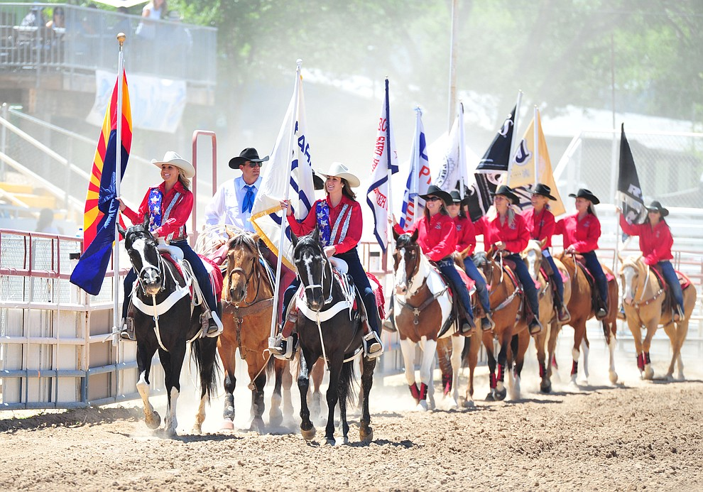 The Grand Entry begins during third performance of the Prescott Frontier Days Rodeo Saturday, June 30, 2018.(Les Stukenberg/Courier)