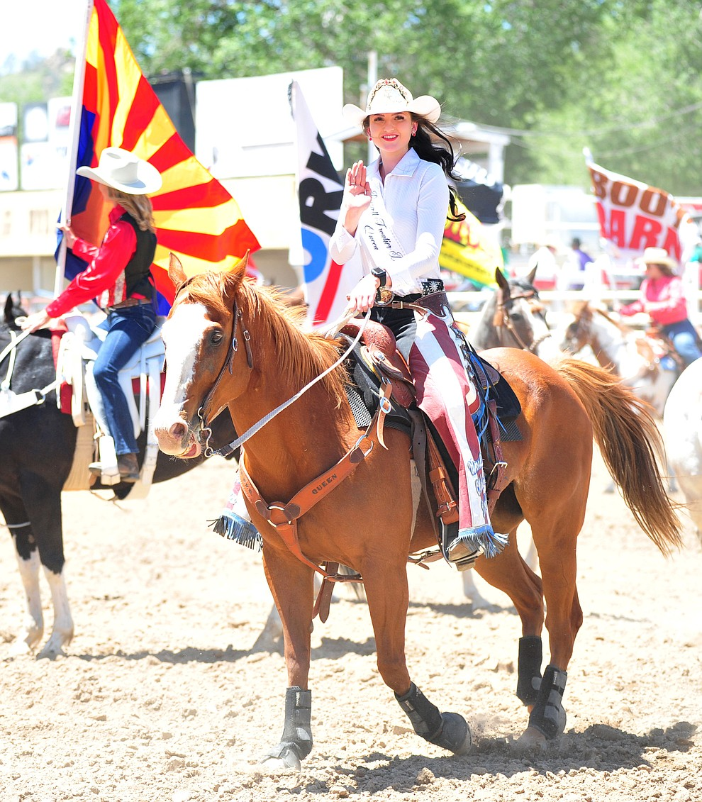 Prescott Frontier Days Rodeo Queen Sarah Grant in the grand entry during third performance of the Prescott Frontier Days Rodeo Saturday, June 30, 2018.(Les Stukenberg/Courier)