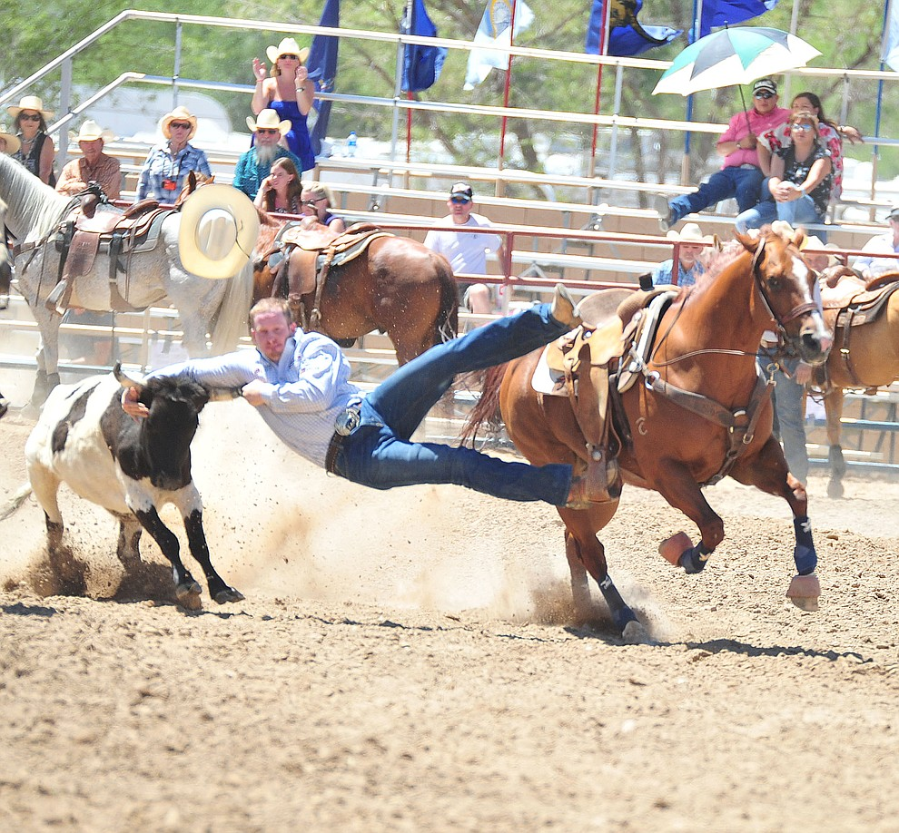 Jake Stocking just misses in the steer wrestling during third performance of the Prescott Frontier Days Rodeo Saturday, June 30, 2018.(Les Stukenberg/Courier)