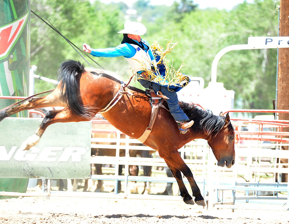 Jamie Howlett on John Boy in the bareback during the third performance of the Prescott Frontier Days Rodeo Saturday, June 30, 2018.(Les Stukenberg/Courier)