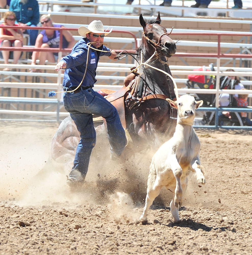 Sterling Smith gets off for a 10.4 second run in the tie down roping during the third performance of the Prescott Frontier Days Rodeo Saturday, June 30, 2018.(Les Stukenberg/Courier)