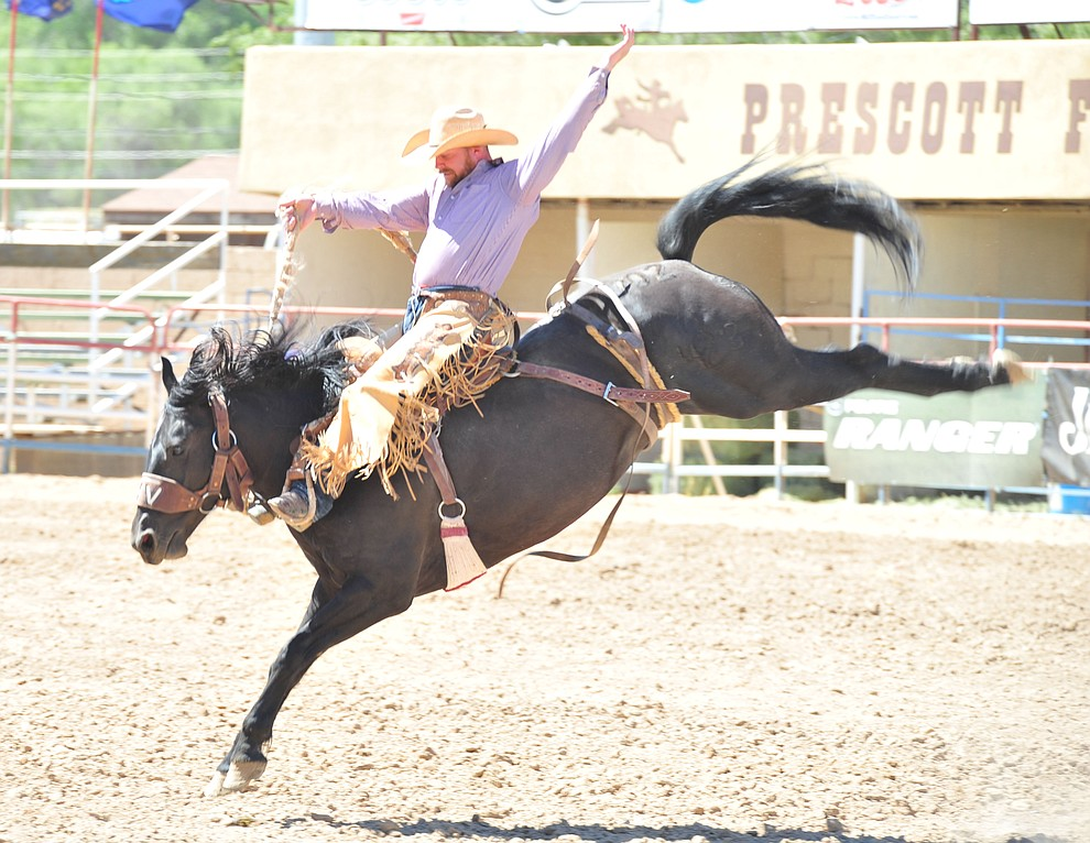 Kobyn Williams scores 82.5 on Mountain Climber in the saddle bronc riding during the third performance of the Prescott Frontier Days Rodeo Saturday, June 30, 2018.(Les Stukenberg/Courier)