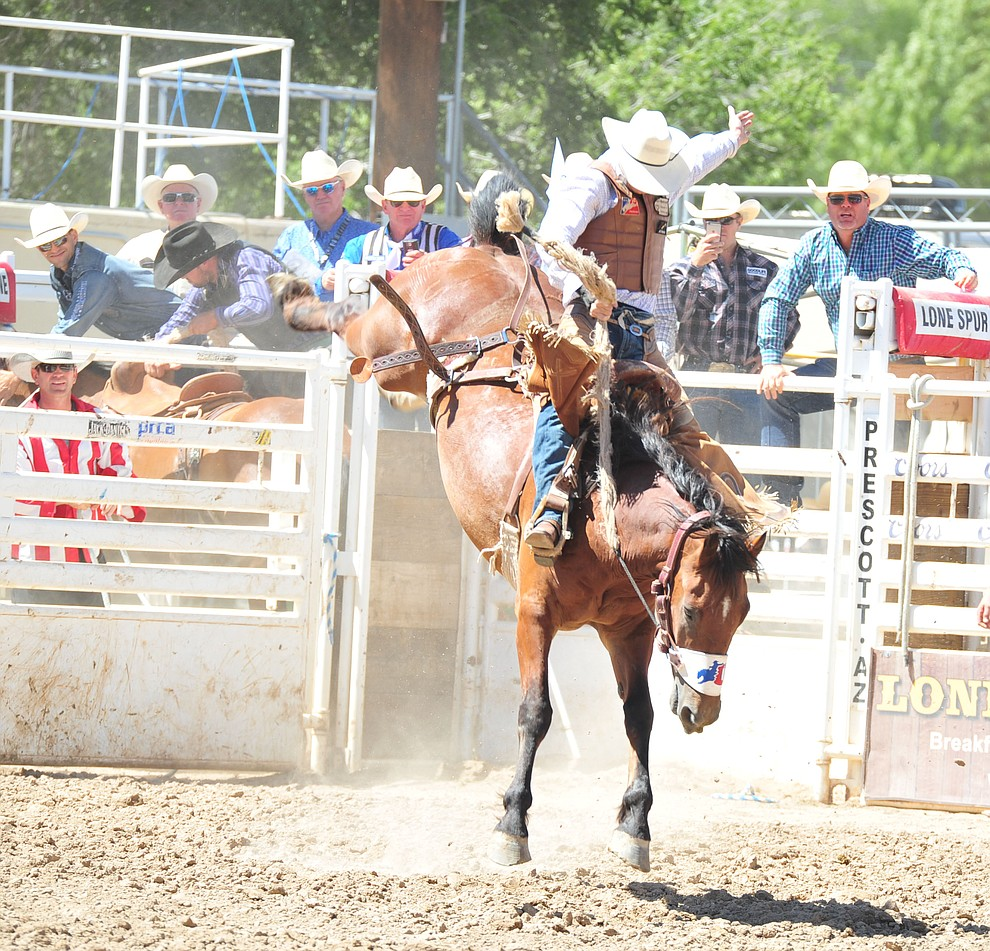 Treyson Antonick scores 76.5 on Mustachio in the saddle bronc riding during the third performance of the Prescott Frontier Days Rodeo Saturday, June 30, 2018.(Les Stukenberg/Courier)