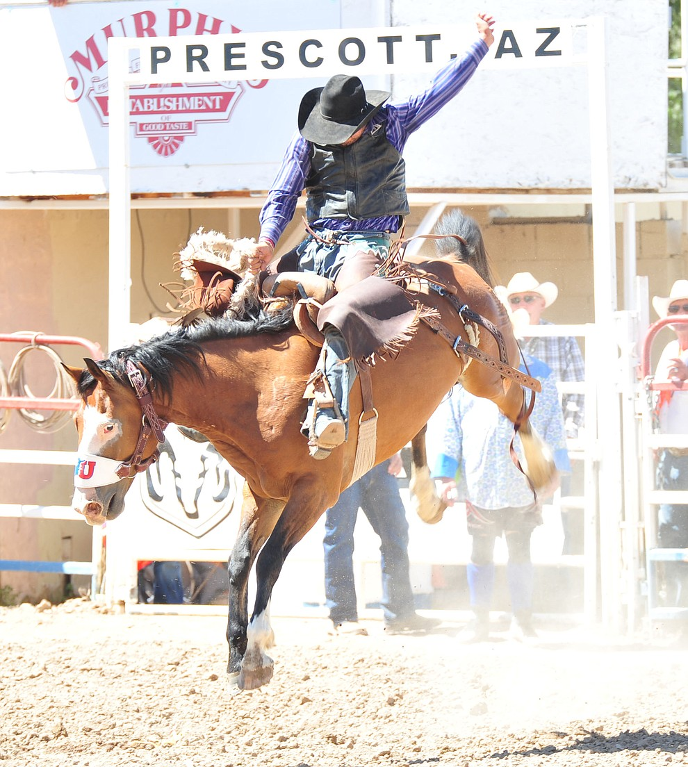 Corey Lefebre scores 64 on Ricochay in the saddle bronc riding during the third performance of the Prescott Frontier Days Rodeo Saturday, June 30, 2018.(Les Stukenberg/Courier)