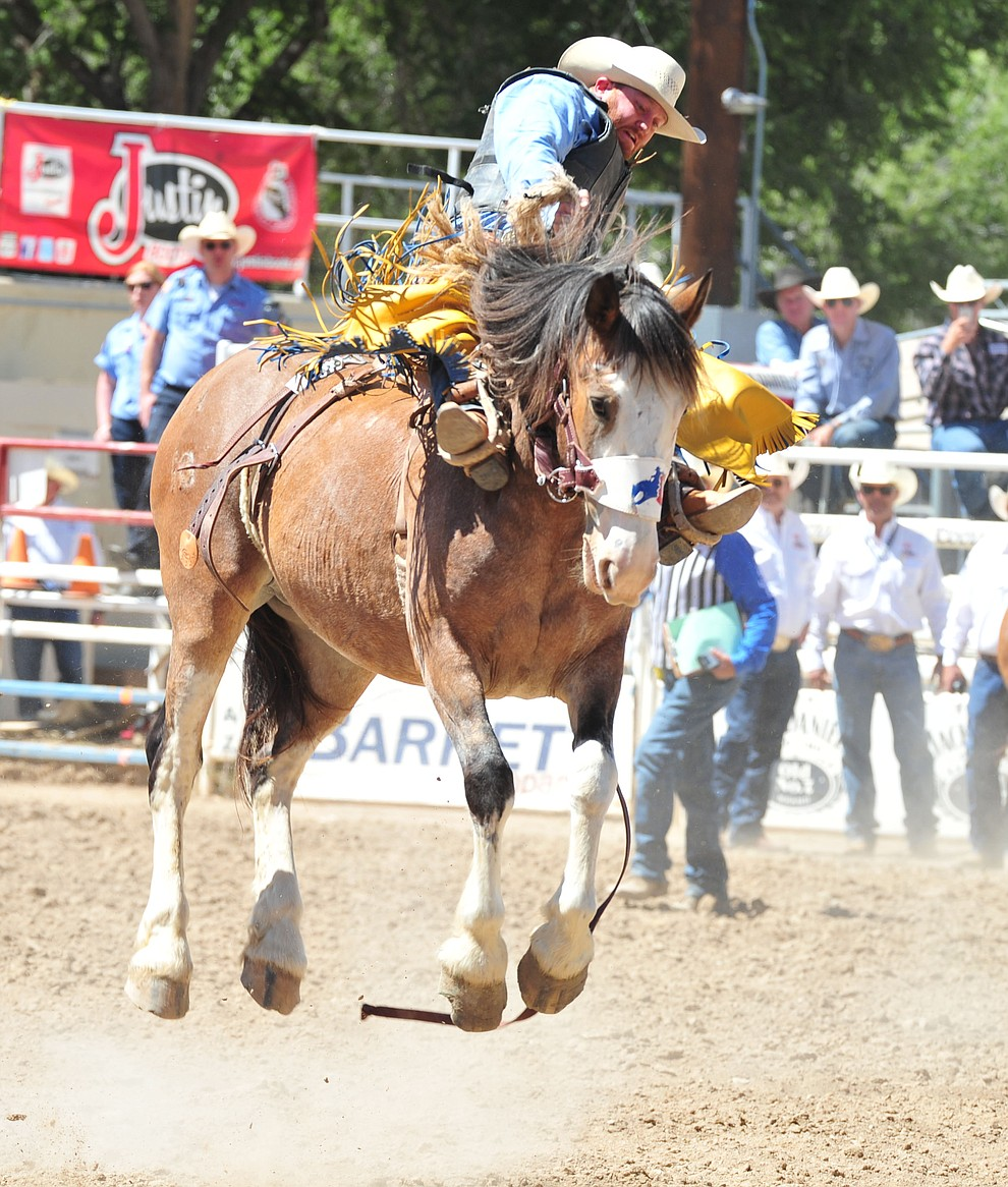 Dean Wadsworth scores on Raise Your Glass in the saddle bronc riding during the third performance of the Prescott Frontier Days Rodeo Saturday, June 30, 2018.(Les Stukenberg/Courier)