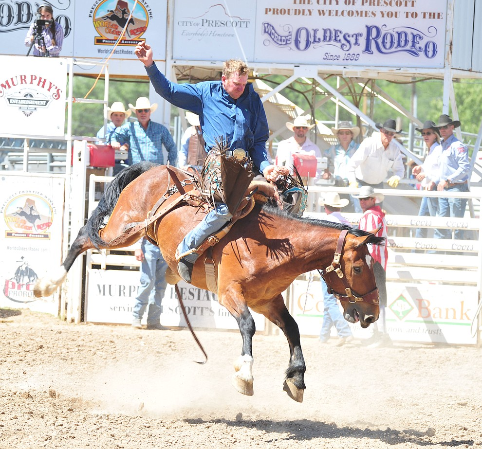 Chad Shaw on Long Ago in the saddle bronc riding during the third performance of the Prescott Frontier Days Rodeo Saturday, June 30, 2018.(Les Stukenberg/Courier)