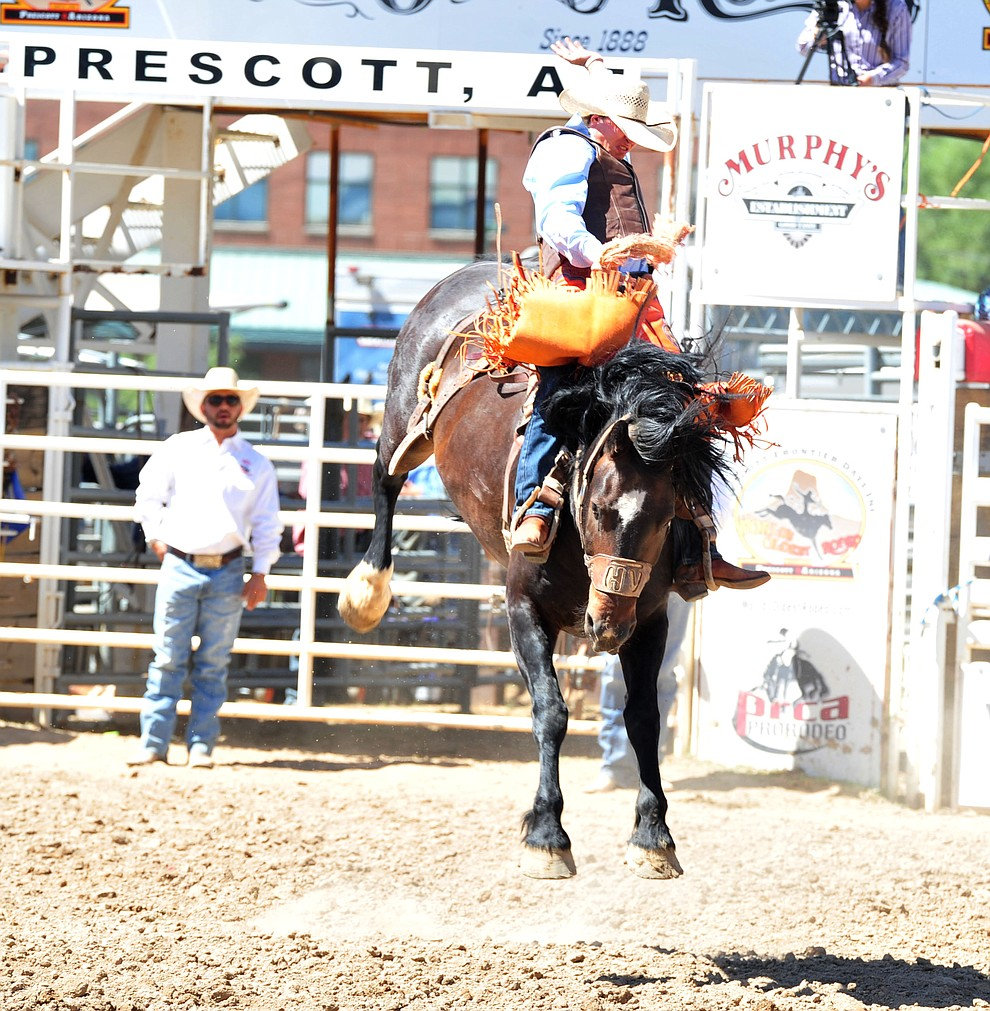 Parker Kempfer on Happy Valley in the saddle bronc riding during the third performance of the Prescott Frontier Days Rodeo Saturday, June 30, 2018.(Les Stukenberg/Courier)