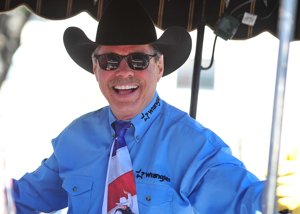 Rodeo announcer Randy Corley served as Grand Marshal for the annual Prescott Frontier Days Parade through the downtown Prescott area Saturday, June 30, 2018.(Les Stukenberg/Courier)