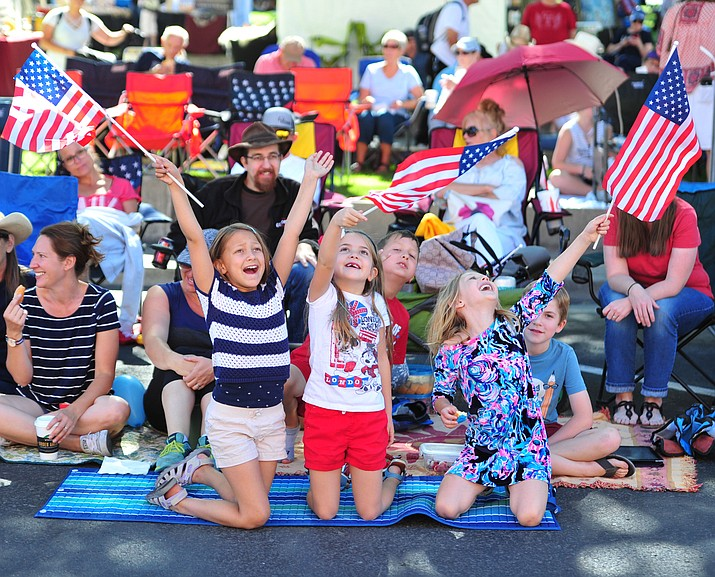 Danika Phillips, Molly Godel and Ada Gautreaux cheer during the annual Prescott Frontier Days Parade through the downtown Prescott area Saturday, June 30, 2018.(Les Stukenberg/Courier)