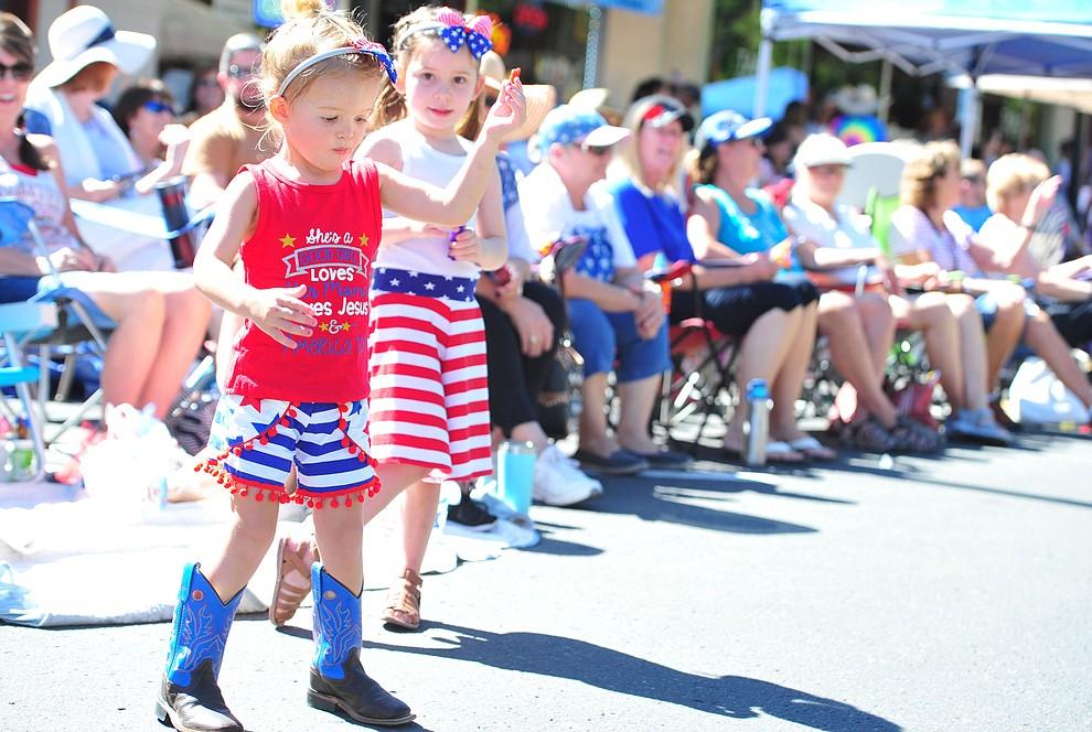 Leightyn Brogdon dances during the annual Prescott Frontier Days Parade through the downtown Prescott area Saturday, June 30, 2018.(Les Stukenberg/Courier)