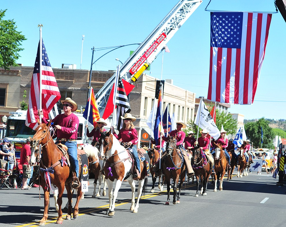 Matt's Saloon brought 19 horseback riders for the annual Prescott Frontier Days Parade through the downtown Prescott area Saturday, June 30, 2018.(Les Stukenberg/Courier)