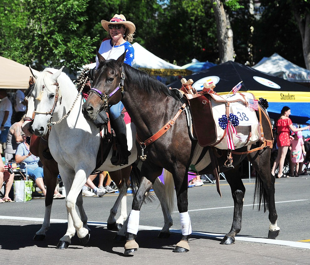 Back Country Horsemen during the annual Prescott Frontier Days Parade through the downtown Prescott area Saturday, June 30, 2018.(Les Stukenberg/Courier)