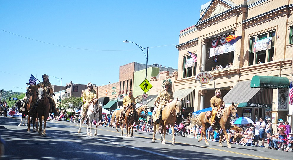 Bill Williams Mountain Men march along Whiskey Row during the annual Prescott Frontier Days Parade through the downtown Prescott area Saturday, June 30, 2018.(Les Stukenberg/Courier)