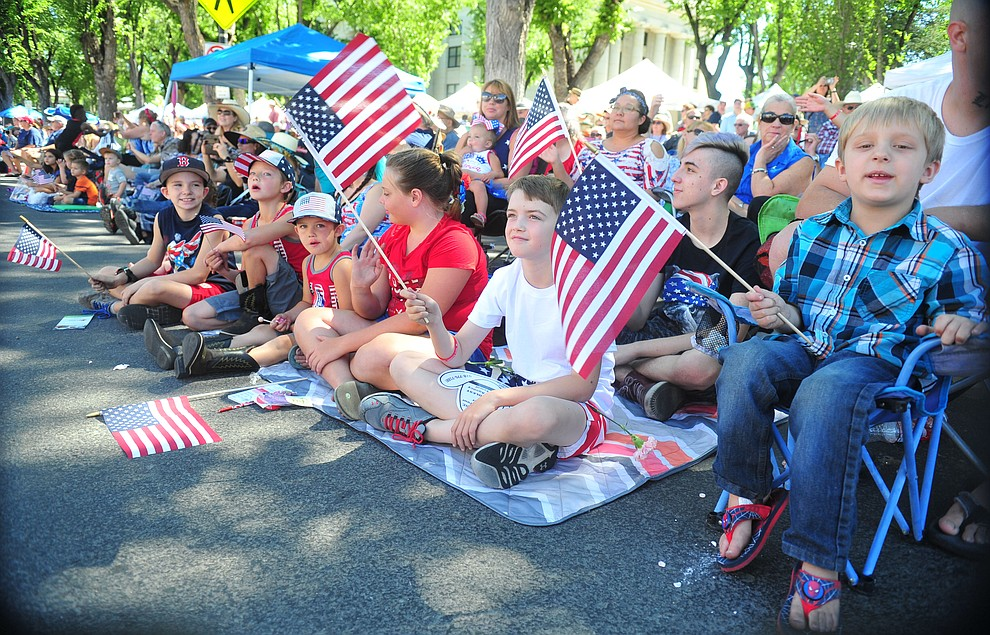 Large crowds gather on the courthouse plaza during the annual Prescott Frontier Days Parade through the downtown Prescott area Saturday, June 30, 2018.(Les Stukenberg/Courier)
