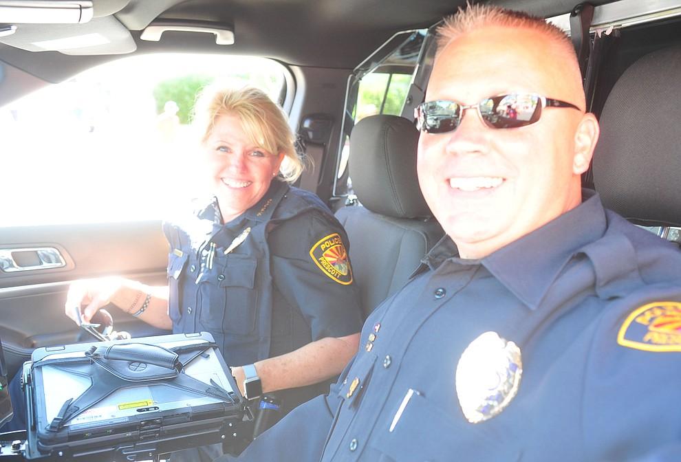 Prescott Police Chief Debra Black and officer Sean Hylton during the annual Prescott Frontier Days Parade through the downtown Prescott area Saturday, June 30, 2018.(Les Stukenberg/Courier)