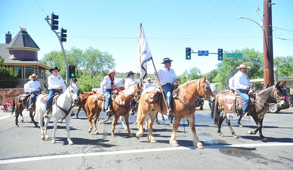 The Phoenix JC Comancheros Pony Express during the annual Prescott Frontier Days Parade through the downtown Prescott area Saturday, June 30, 2018.(Les Stukenberg/Courier)
