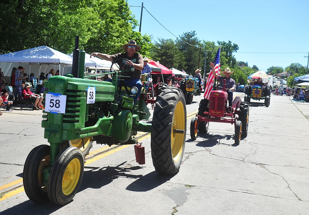Mile High Tractor and Engine Club during the annual Prescott Frontier Days Parade through the downtown Prescott area Saturday, June 30, 2018.(Les Stukenberg/Courier)