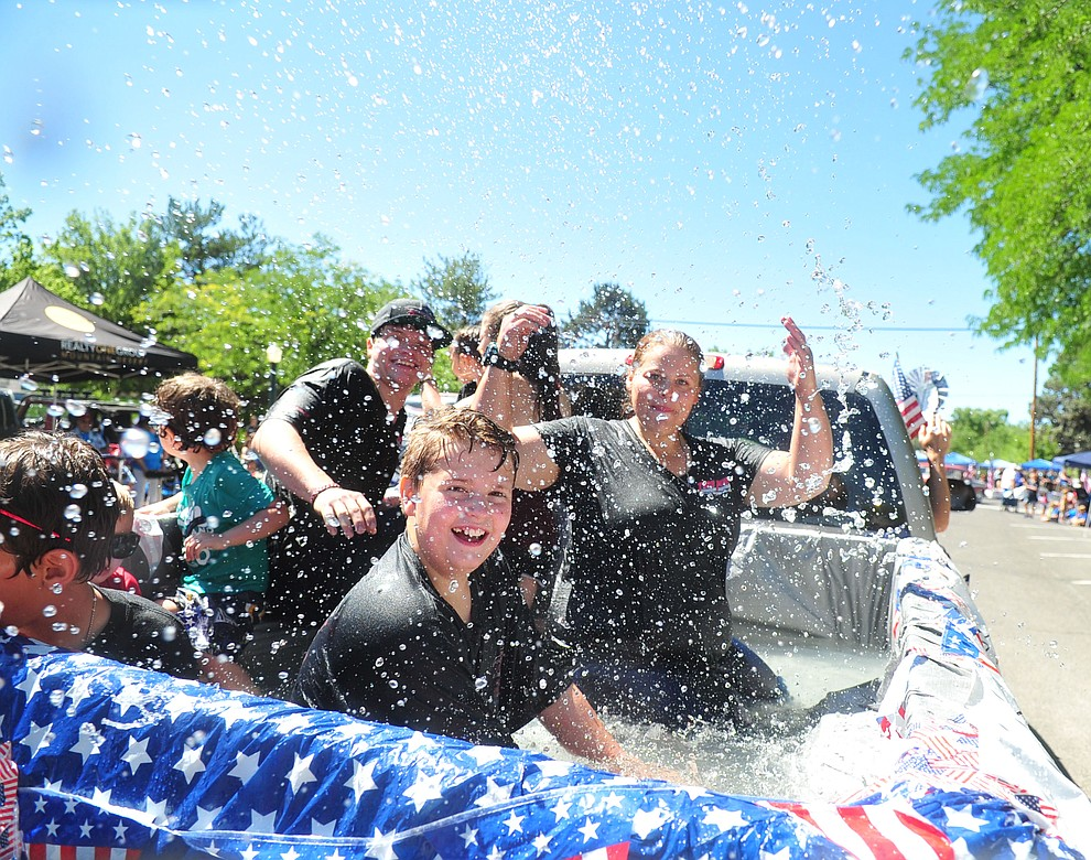 ONe group even brought a truckbed pool to cool people down to the annual Prescott Frontier Days Parade through the downtown Prescott area Saturday, June 30, 2018.(Les Stukenberg/Courier)