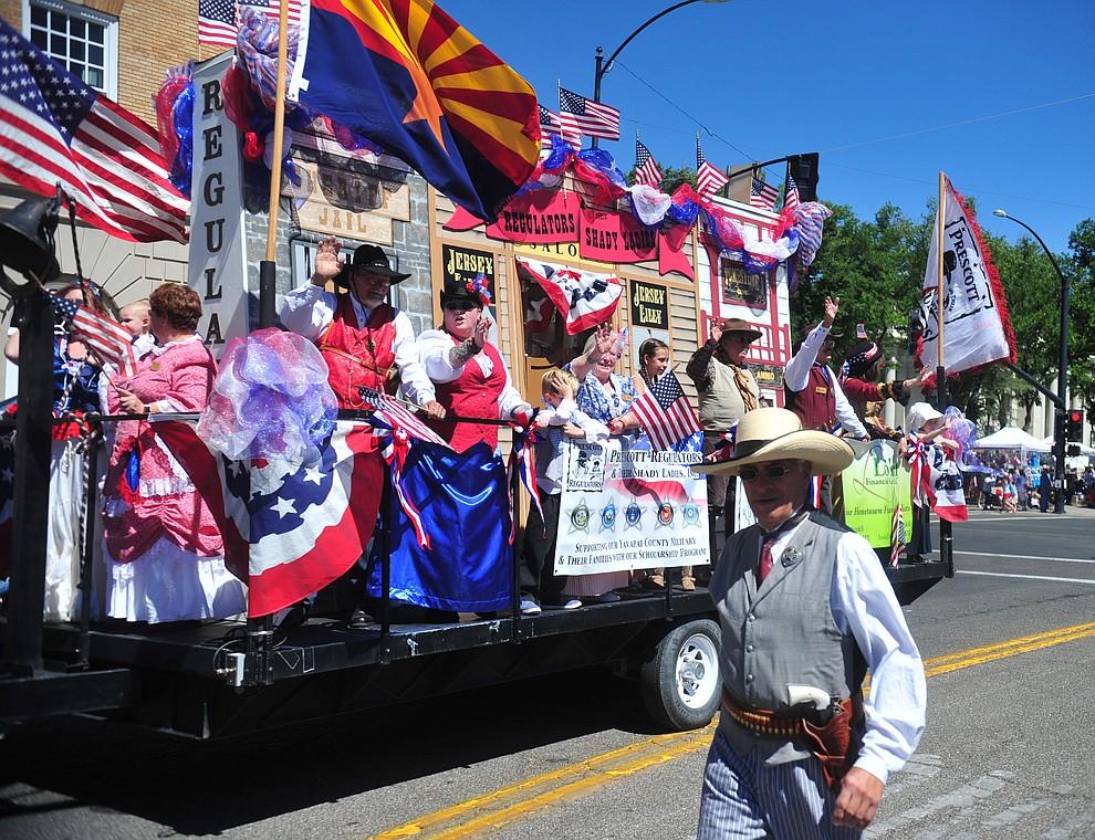 Prescott Regulators and their Shady Ladies during the annual Prescott Frontier Days Parade through the downtown Prescott area Saturday, June 30, 2018.(Les Stukenberg/Courier)