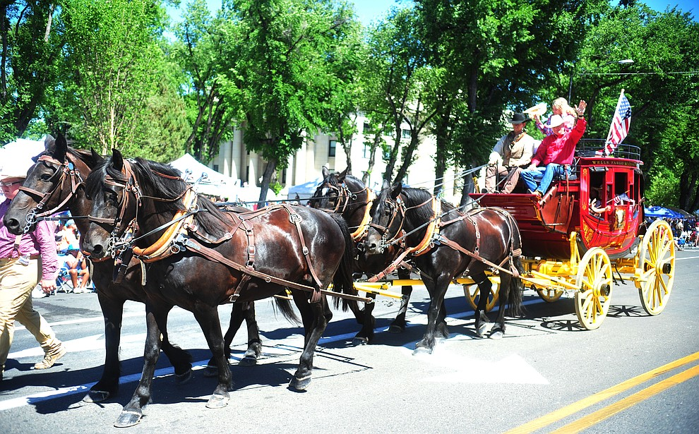 Wells Fargo brought their stagecoach to the annual Prescott Frontier Days Parade through the downtown Prescott area Saturday, June 30, 2018.(Les Stukenberg/Courier)