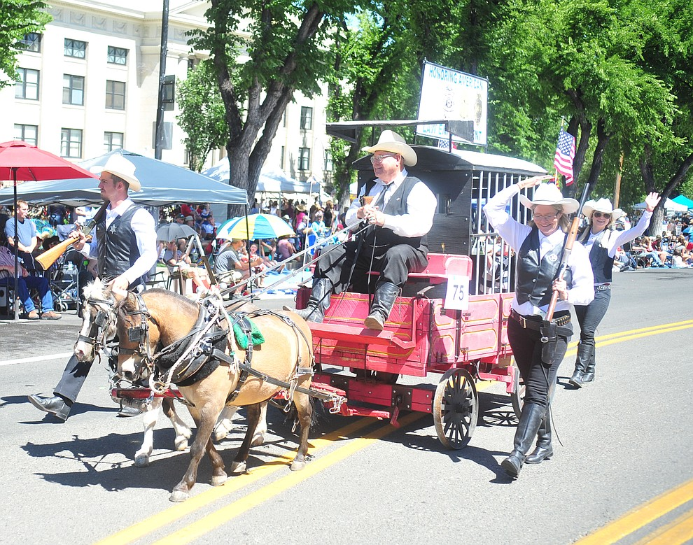 Willie, Keebler and the antique prison wagon during the annual Prescott Frontier Days Parade through the downtown Prescott area Saturday, June 30, 2018.(Les Stukenberg/Courier)