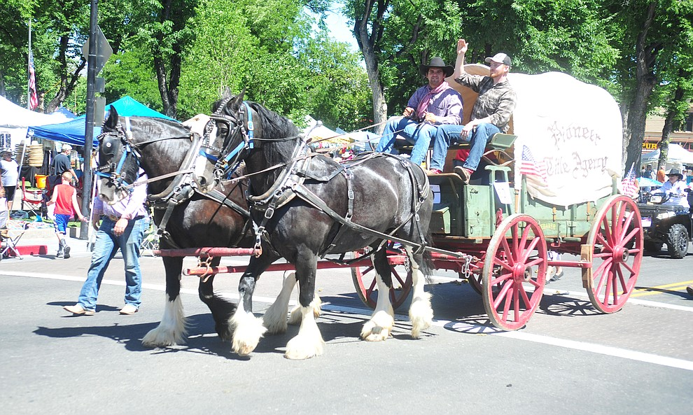 Pioneer Title Agency brought a covered wagon to the annual Prescott Frontier Days Parade through the downtown Prescott area Saturday, June 30, 2018.(Les Stukenberg/Courier)