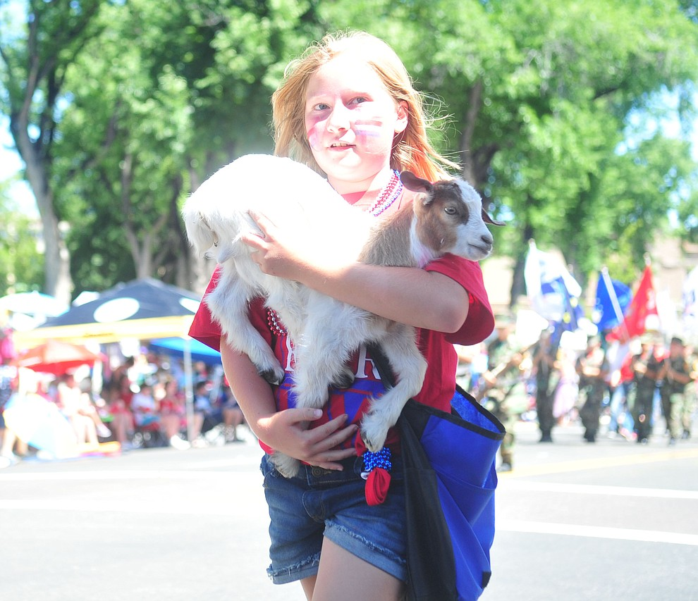 What's cuter than a baby goat during the annual Prescott Frontier Days Parade through the downtown Prescott area Saturday, June 30, 2018.(Les Stukenberg/Courier)