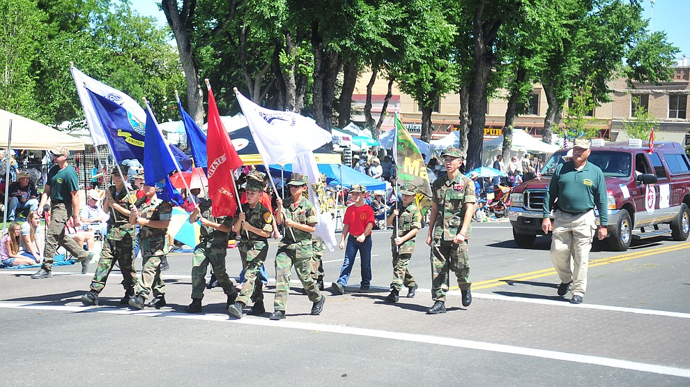 Young Marines march during the annual Prescott Frontier Days Parade through the downtown Prescott area Saturday, June 30, 2018.(Les Stukenberg/Courier)