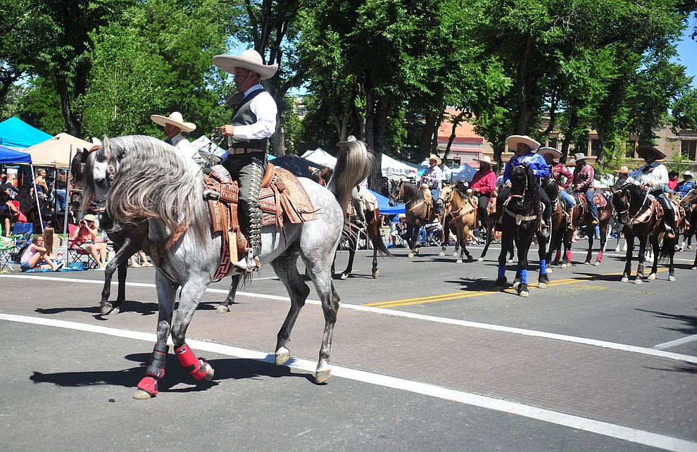 Cabalgando X Arizona and their fast footed horses during the annual Prescott Frontier Days Parade through the downtown Prescott area Saturday, June 30, 2018.(Les Stukenberg/Courier)