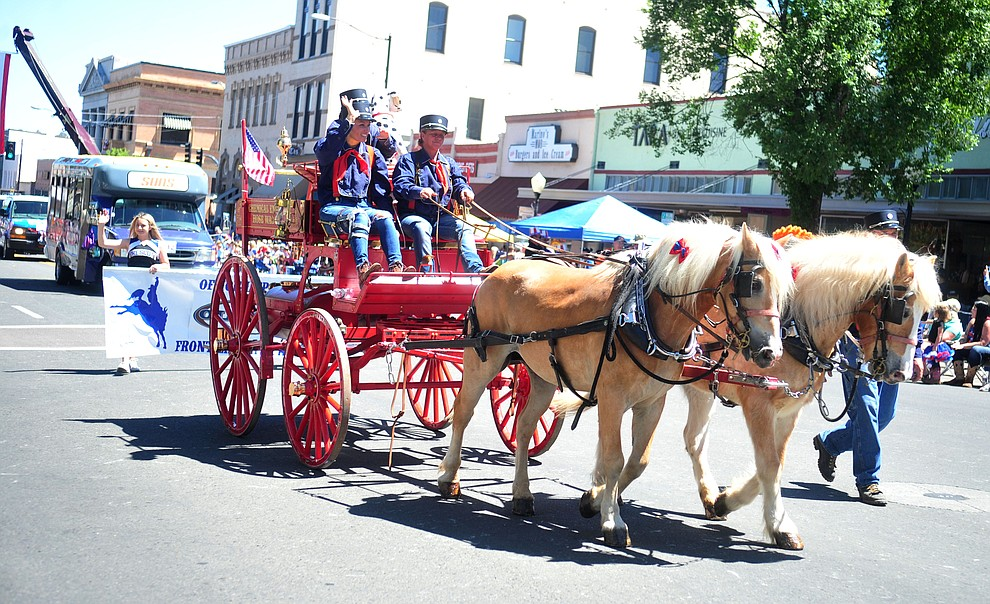 Firefighters are champions during the annual Prescott Frontier Days Parade through the downtown Prescott area Saturday, June 30, 2018.(Les Stukenberg/Courier)