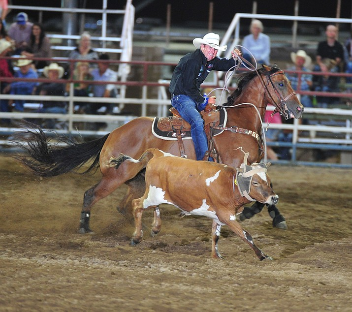 Trevor Brazile ropes his steer in the team roping during the opening performance of the Prescott Frontier Days Rodeo Thursday, June 28, 2018. (Les Stukenberg/Courier)