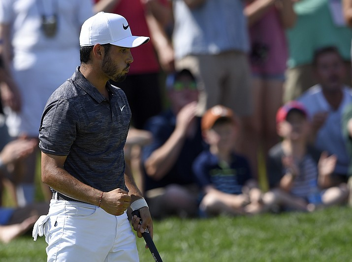 Abraham Ancer, of Mexico, reacts after his putt on the 16th green during the third round of the Quicken Loans National golf tournament, Saturday, June 30, 2018, in Potomac, Md. (Nick Wass/AP Photo)