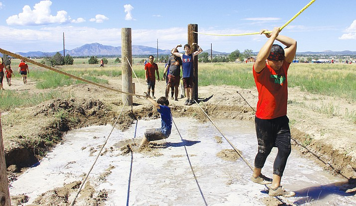 Participants of the 2nd annual Chino Mudder take on Tightrope Shuffle, one of the course's 21 obstacles on Aug. 27, 2017. Changing its name earlier this year, registration for the Chino Mud Run is now open for Saturday, Aug. 25, event. (Max Efrein/Review, File)