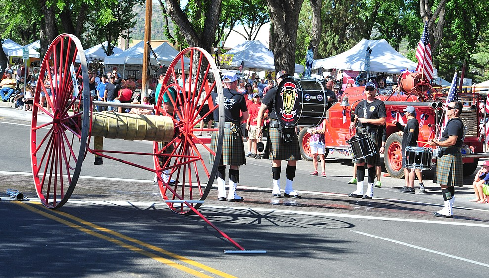 Central Arizona Pipe and Drums opens the annual Hose Cart Races and Bucket Brigade held in downtown Prescott Sunday July 1, 2018. The annual event recreates actual competitions held by early Prescott fire companies from the late 1880's like the Tough's Hose Company Number 1, the Dudes Hose Company Number 2, the Mechanics Hook and Ladder Company Number 1 and the O.K Hose Company Number 3. (Les Stukenberg/Courier)