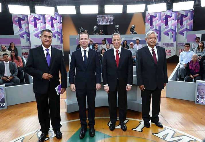 "Mexico presidential candidates, from left, independent Jaime Rodriguez, known as ""El Bronco,"" Ricardo Anaya of the Forward for Mexico Coalition, Jose Antonio Meade, of the Institutional Revolutionary Party, and Andres Manuel Lopez Obrador, with the MORENA party, attend the second of three debates in Tijuana, Mexico. (National Electoral Institute, INE, File)"