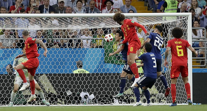 Belgium's Marouane Fellaini scores his side's second goal with his head during the round of 16 match between Belgium and Japan at the 2018 soccer World Cup in the Rostov Arena, in Rostov-on-Don, Russia, Monday, July 2, 2018. (Petr David Josek/AP Photo)