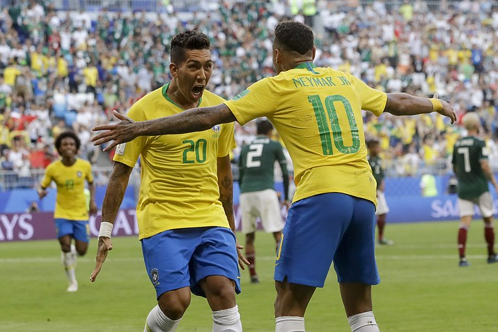 Brazil's Roberto Firmino, left, celebrates with Brazil's Neymar, right, after scoring his side's second goal during the round of 16 match between Brazil and Mexico at the 2018 soccer World Cup in the Samara Arena, in Samara, Russia, Monday, July 2, 2018. (Andre Penner/AP Photo)