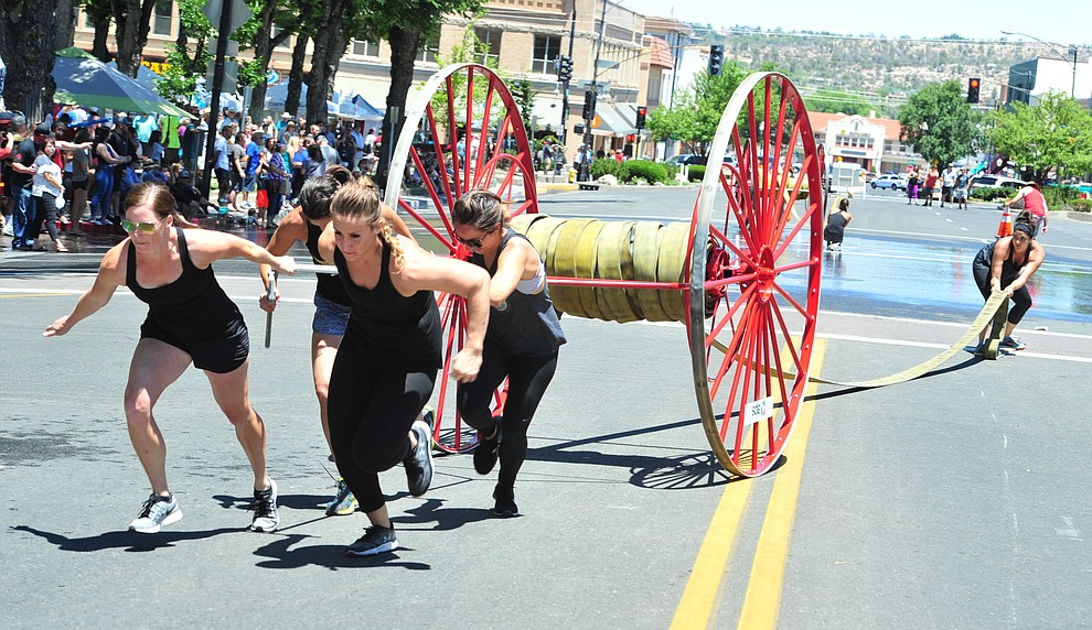 The ladies team of Boats and Hoses won both events during the annual Hose Cart Races and Bucket Brigade held in downtown Prescott Sunday July 1, 2018. The annual event recreates actual competitions held by early Prescott fire companies from the late 1880's like the Tough's Hose Company Number 1, the Dudes Hose Company Number 2, the Mechanics Hook and Ladder Company Number 1 and the O.K Hose Company Number 3. (Les Stukenberg/Courier)