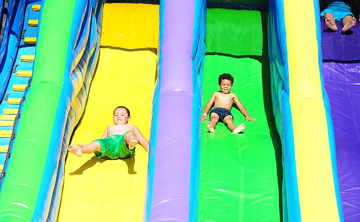 Fourth of July festivities in Prescott Valley have been relocated from Mountain Valley Park to the Prescott Valley Civic Center, 7501 E. Civic Circle, and will run from 3 to 9 p.m. Beginning at 3 p.m., Hero Party Rental will offer bounce houses and inflatables, five lanes of water slides, six lanes of dry slides, a Chaos Obstacle course, Vertical Reality Bungee Trampoline, a 24-foot-high rock wall, a Human Gyroscope and Battle Zone. The cost for those attractions has been lowered to $15 per person. (Les Stukenberg/Courier file photo)