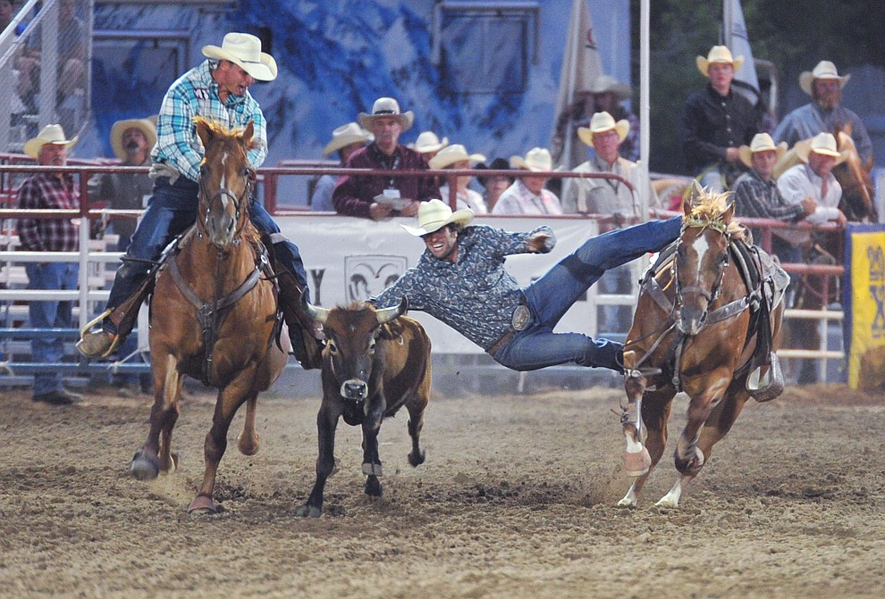 Cutter Parsons drops in during the steer wrestling in the 5th performance of the Prescott Frontier Days Rodeo Sunday, July 1, 2018. (Les Stukenberg/Courier)