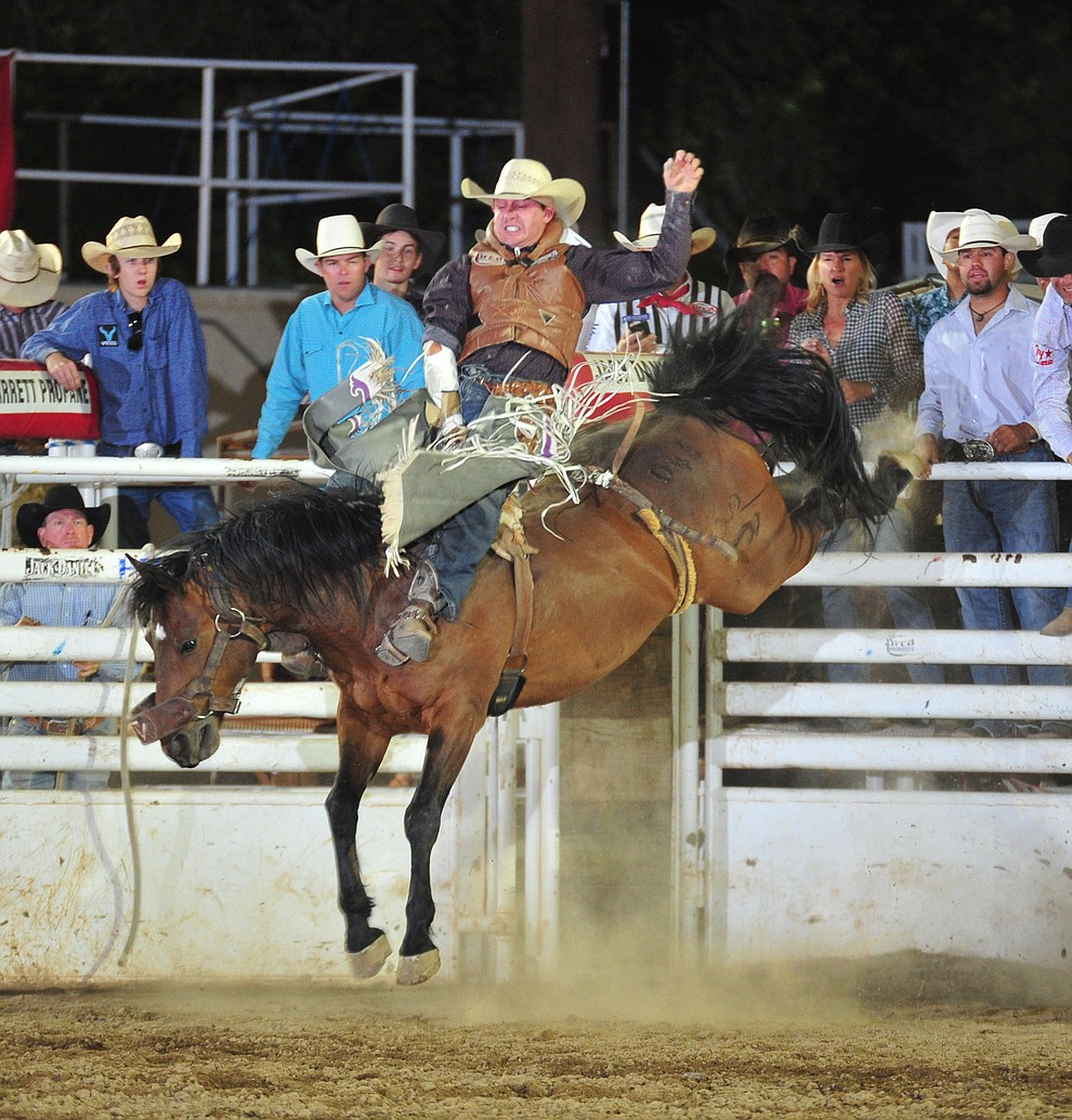Shon Gibson scores 76 on Billy the Kid in the bareback during the 5th performance of the Prescott Frontier Days Rodeo Sunday, July 1, 2018. (Les Stukenberg/Courier)