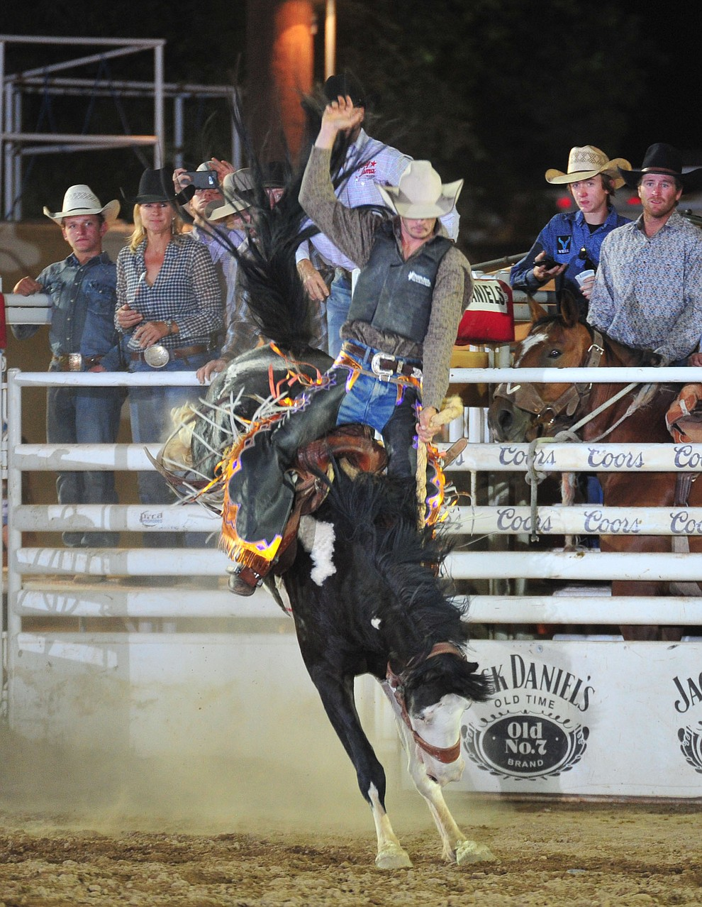 Chino Valley's Dylan Coglianese rides in the saddle bronc during the 5th performance of the Prescott Frontier Days Rodeo Sunday, July 1, 2018. (Les Stukenberg/Courier)
