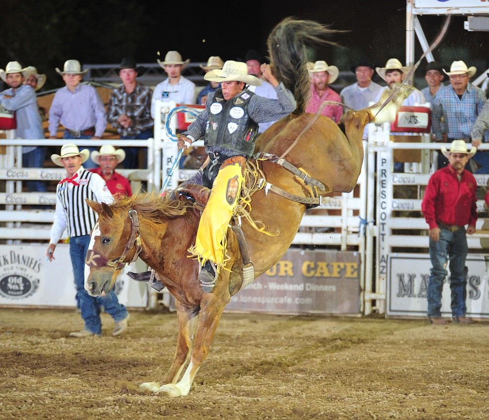Jay Joaquin scores 85.5 on Snort in the saddle bronc during the 5th performance of the Prescott Frontier Days Rodeo Sunday, July 1, 2018. (Les Stukenberg/Courier)