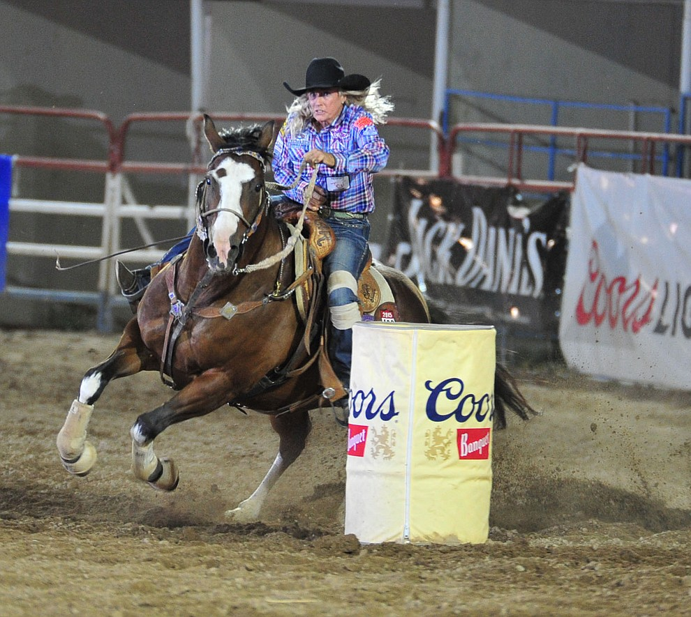 Vickie Carter in the barrel race during the 5th performance of the Prescott Frontier Days Rodeo Sunday, July 1, 2018. (Les Stukenberg/Courier)