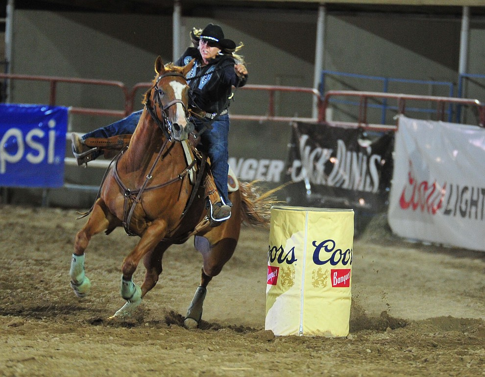 Brandy Sanchez in the barrel race during the 5th performance of the Prescott Frontier Days Rodeo Sunday, July 1, 2018. (Les Stukenberg/Courier)