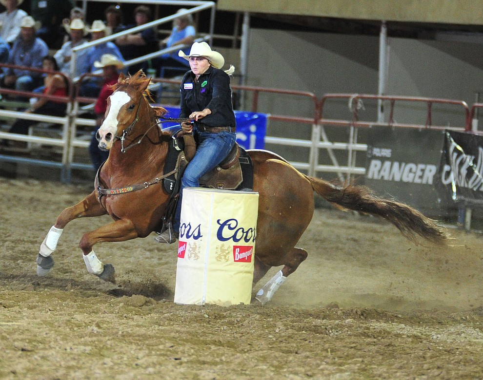 Katie Pascoe in the barrel race during the 5th performance of the Prescott Frontier Days Rodeo Sunday, July 1, 2018. (Les Stukenberg/Courier)