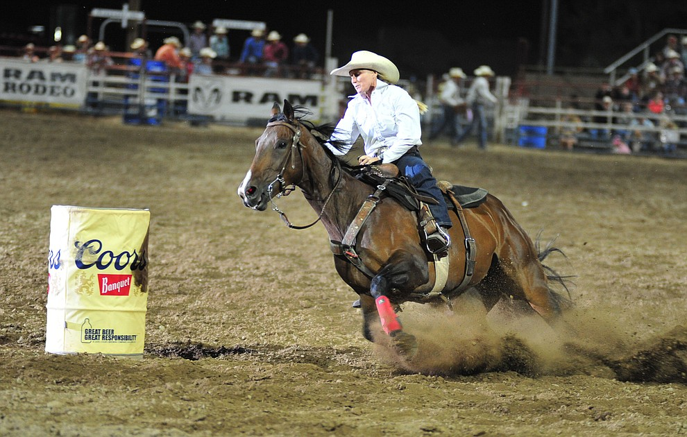 Nicole Demers in the barrel race during the 5th performance of the Prescott Frontier Days Rodeo Sunday, July 1, 2018. (Les Stukenberg/Courier)