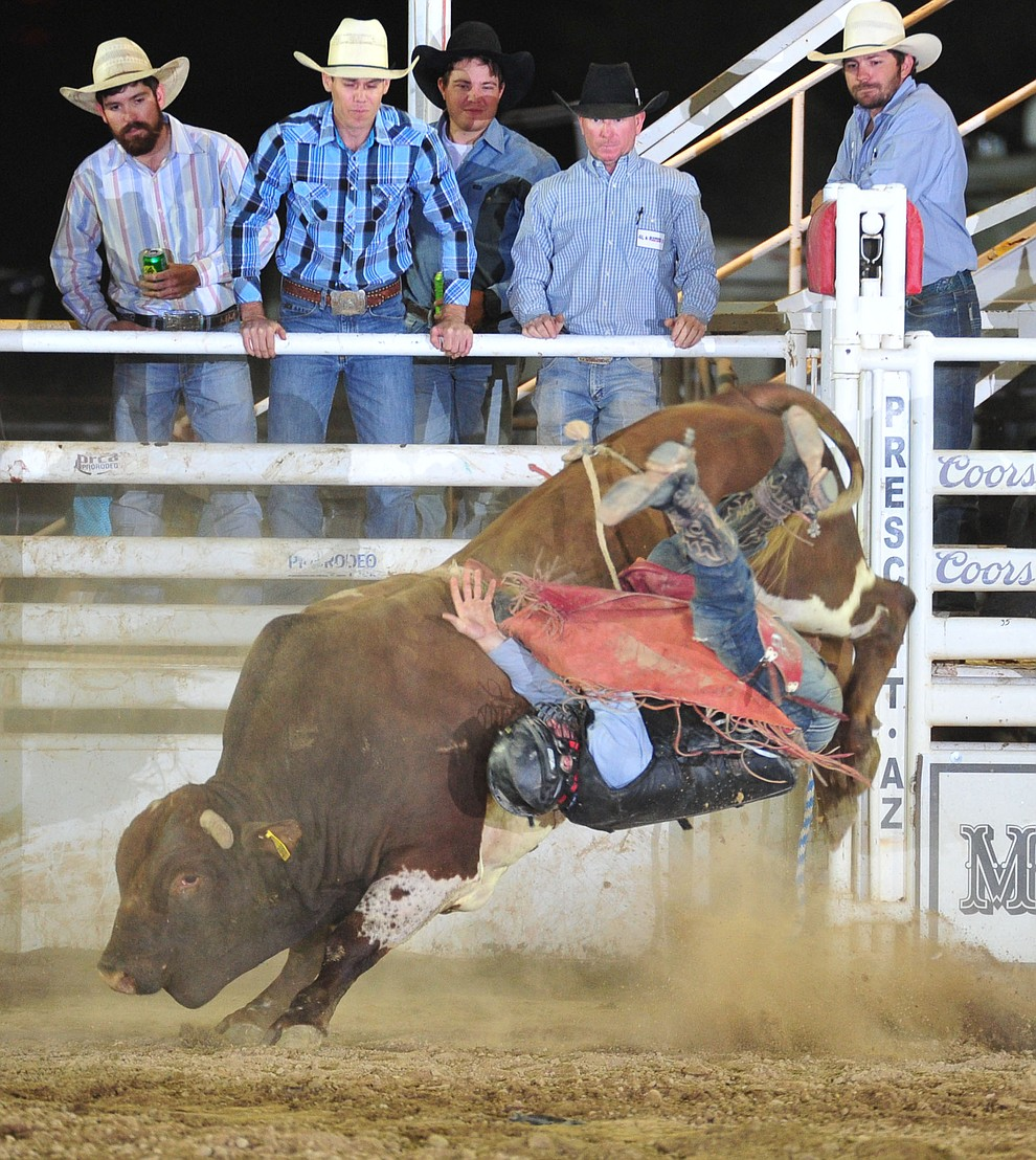 J.T. Pettitt gets thrown by HTTR in the bull riding during the 5th performance of the Prescott Frontier Days Rodeo Sunday, July 1, 2018. (Les Stukenberg/Courier)